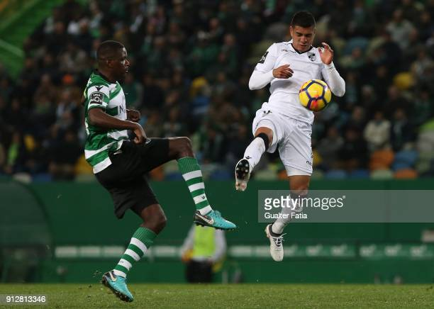 Vitoria Guimaraes forward Paolo Hurtado from Peru with Sporting CP midfielder William Carvalho from Portugal in action during the Primeira Liga match...