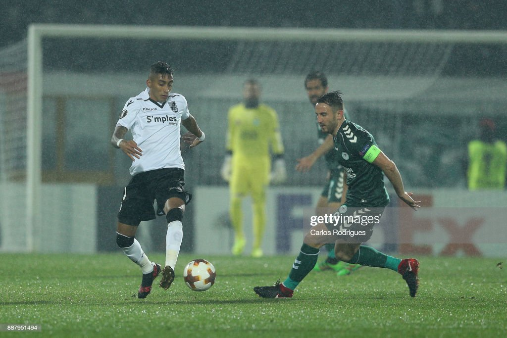 Vitoria Guimaraes forward Raphinha from Brasil (L) vies with Konyaspor midfielder Ali Camdali from Turkey (R) for the ball possession during the match between Vitoria Guimaraes and Atiker Konyaspor match for UEFA Europa League at Estadio da Dom Afonso Henriques on December 07, 2017 in Guimaraes, Portugal.