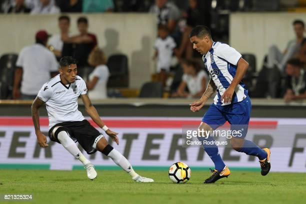 Vitoria Guimaraes forward Raphinha from Brazil vies FC Porto defender Maxi Pereira from Uruguay during the match between Vitoria Guimaraes v FC Porto...