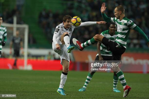 Vitoria Guimaraes midfielder Rafael Miranda from Brasil vies with Sporting CP forward Bas Dost from Holland for the ball possession during the...