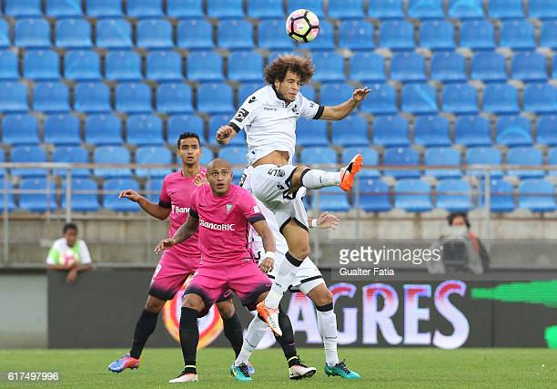 Vitoria Guimaraes' midfielder Rafael Miranda with Estoril's forward Paulo Henrique from Brazil in action during the Primeira Liga match between GD...