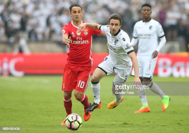 Vitoria Guimaraes' midfielder Rafael Miranda with SL Benfica's forward from Brazil Jonas in action during the Portuguese Cup Final match between SL...