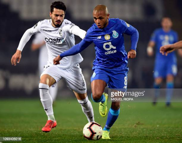 Vitoria Guimaraes' Portuguese midfielder Pepe Rodrigues vies with Porto's Algerian forward Yacine Brahimi during the Portuguese League football match...