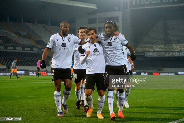 Vitoria Guimaraes' Portuguese midfielder Rochinha celebrates with teammates after scoring a goal during the Portuguese League football match between...