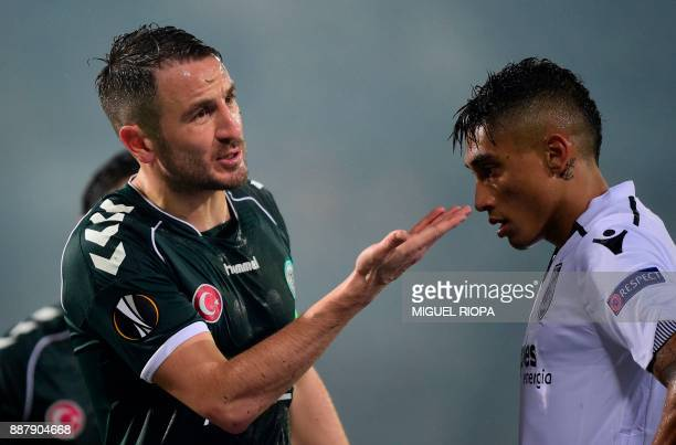 Vitoria Guimaraes' South African midfielder Bongani Zungu argues with the referee next to Vitoria Guimaraes' Brazilian midfielder Raphinha during the...