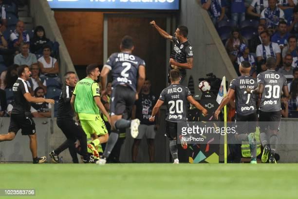 Vitoria SC's Brazilian forward Davidson celebrates after scoring a goal during the Premier League 2018/19 match between FC Porto and Vitoria SC at...