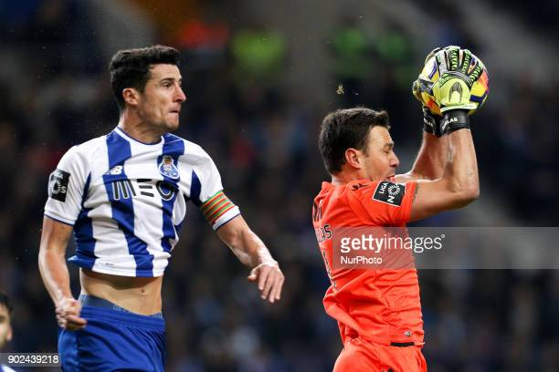 Vitoria SC's Brazilian goalkeeper Douglas in action with Porto's Spanish defender Ivan Marcano during the Premier League 2017/18 match between FC...