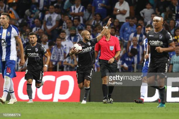 Vitoria SC's Portuguese midfielder Andre Andre celebrates after scoring a goal during the Premier League 2018/19 match between FC Porto and Vitoria...