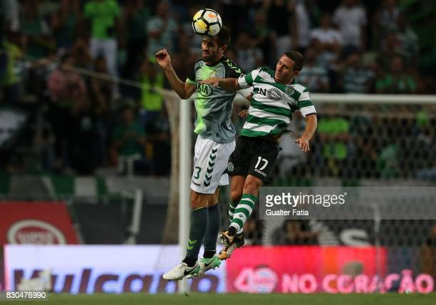 Vitoria Setubal defender Frederico Venancio from Portugal with Sporting CP forward Daniel Pondence from Portugal in action during the Primeira Liga...