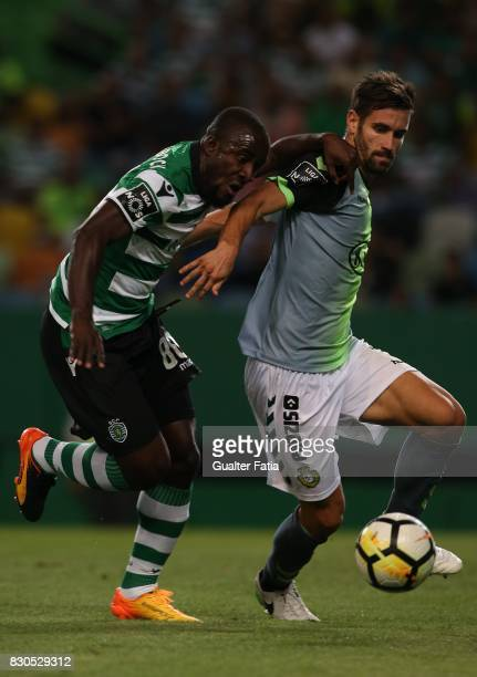 Vitoria Setubal defender Frederico Venancio from Portugal with Sporting CP forward Seydou Doumbia from Ivory Coast in action during the Primeira Liga...