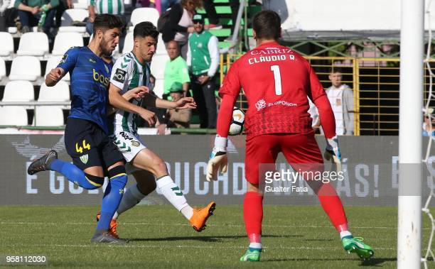 Vitoria Setubal forward Andre Pereira from Portugal with CD Tondela defender Jorge Fernando from Portugal in action during the Primeira Liga match...