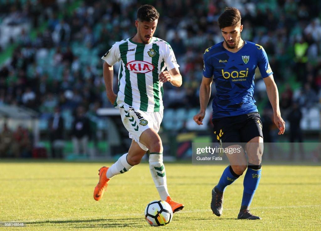 Vitoria Setubal forward Andre Pereira from Portugal with CD Tondela defender Jorge Fernando from Portugal in action during the Primeira Liga match between Vitoria Setubal and CD Tondela at Estadio do Bonfim on April 13, 2018 in Setubal, Portugal.