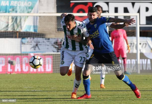 Vitoria Setubal forward Andre Pereira from Portugal with CD Tondela defender Joaozinho from Portugal in action during the Primeira Liga match between...