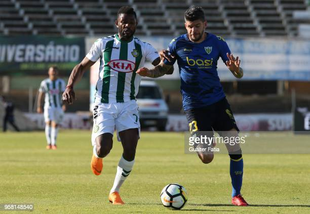 Vitoria Setubal forward Arnold Issoko from Congo with CD Tondela defender Joaozinho from Portugal in action during the Primeira Liga match between...