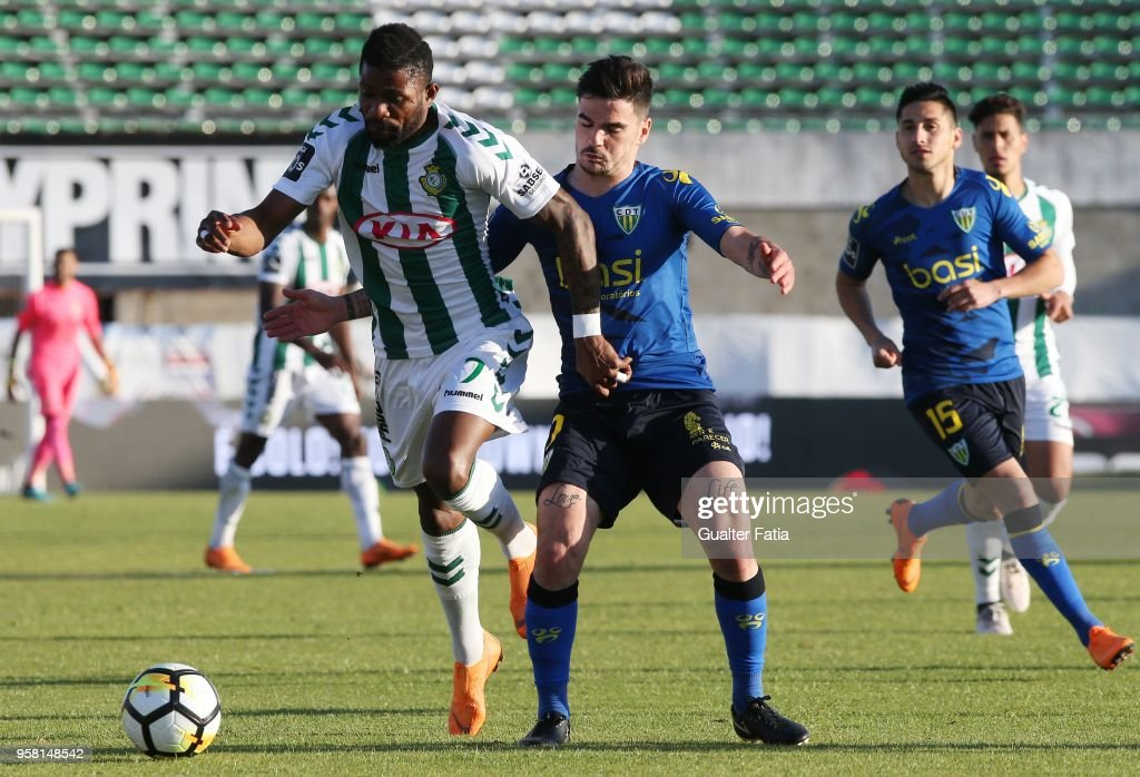 Vitoria Setubal forward Arnold Issoko from Congo with CD Tondela midfielder Claude Goncalves from Portugal in action during the Primeira Liga match between Vitoria Setubal and CD Tondela at Estadio do Bonfim on April 13, 2018 in Setubal, Portugal.