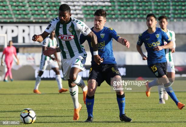 Vitoria Setubal forward Arnold Issoko from Congo with CD Tondela midfielder Claude Goncalves from Portugal in action during the Primeira Liga match...