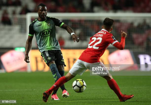 Vitoria Setubal forward Arnold Issoko from Congo with SL Benfica forward Franco Cervi from Argentina in action during the Primeira Liga match between...