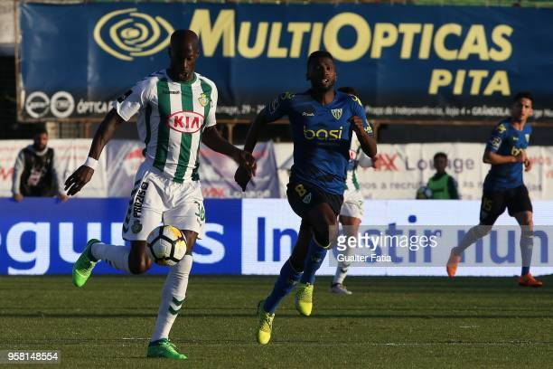 Vitoria Setubal forward Edinho from Portugal with CD Tondela midfielder Helder Tavares from Portugal in action during the Primeira Liga match between...