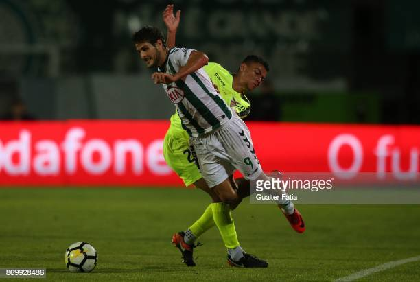 Vitoria Setubal forward Goncalo Paciencia from Portugal tackled by CD Aves midfielder Claudio Falcao from Brazil during the Primeira Liga match...