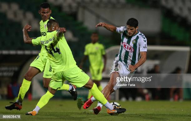 Vitoria Setubal forward Goncalo Paciencia from Portugal with CD Aves defender Diego Galo from Brazil in action during the Primeira Liga match between...