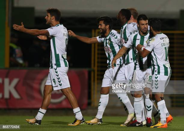 Vitoria Setubal forward Joao Amaral celebrates with teammates after scoring a goal during the Primeira Liga match between Vitoria Setubal and...
