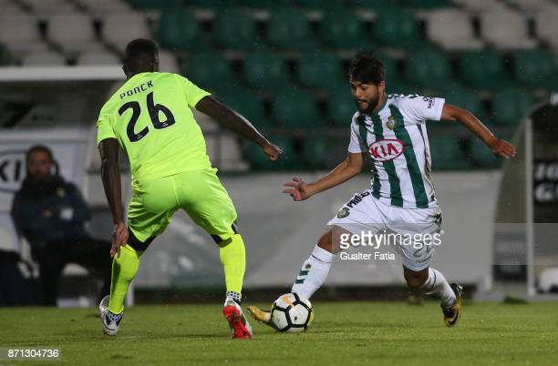 Vitoria Setubal forward Joao Amaral from Portugal with CD Aves defender Carlos Ponck from Cape Verde in action during the Primeira Liga match between...