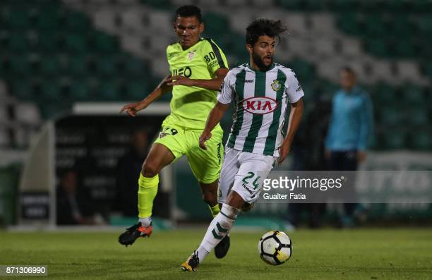 Vitoria Setubal forward Joao Amaral from Portugal with CD Aves midfielder Claudio Falcao from Brazil in action during the Primeira Liga match between...