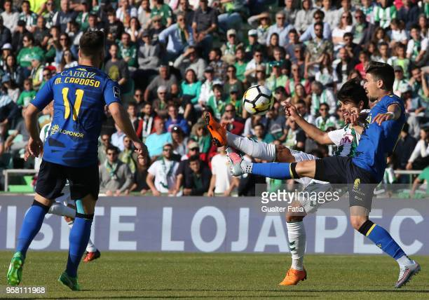 Vitoria Setubal forward Joao Amaral from Portugal with CD Tondela midfielder Pedro Nuno from Portugal in action during the Primeira Liga match...