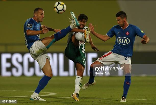Vitoria Setubal forward Joao Amaral from Portugal with CF Os Belenenses midfielder Hassan Yebda from Algeria and CF Os Belenenses defender Florent...