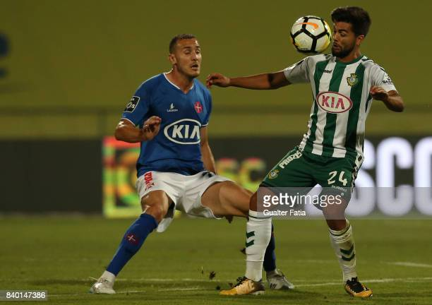 Vitoria Setubal forward Joao Amaral from Portugal with CF Os Belenenses midfielder Hassan Yebda from Algeria in action during the Primeira Liga match...