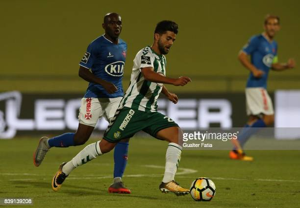 Vitoria Setubal forward Joao Amaral from Portugal with CF Os Belenenses midfielder Merlin Tandjigora from Gabon in action during the Primeira Liga...