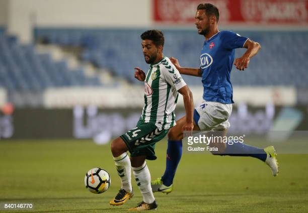 Vitoria Setubal forward Joao Amaral from Portugal with CF Os Belenenses defender Vincent Sasso from France in action during the Primeira Liga match...