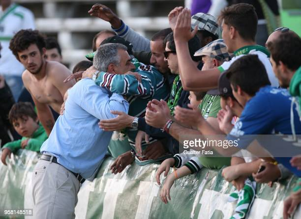 Vitoria Setubal head coach Jose Couceiro from Portugal celebrate with supporters after the victory at the end of the Primeira Liga match between...