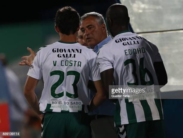 Vitoria Setubal head coach Jose Couceiro from Portugal talks to Vitoria Setubal forward Vasco Costa from Portugal and Vitoria Setubal forward Edinho...