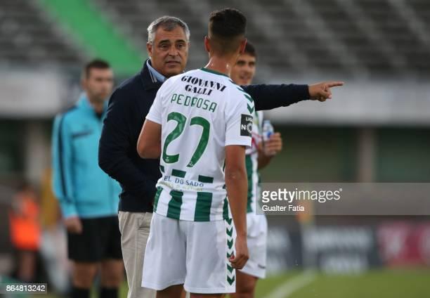 Vitoria Setubal head coach Jose Couceiro from Portugal talks to Vitoria Setubal midfielder Andre Pedrosa from Portugal during the Primeira Liga match...