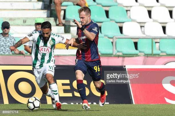 Vitoria Setubal midfielder Joao Costinha from Portugal tries to escape GD Chaves defender Rafael Furlan from Brazil during the match between Vitoria...