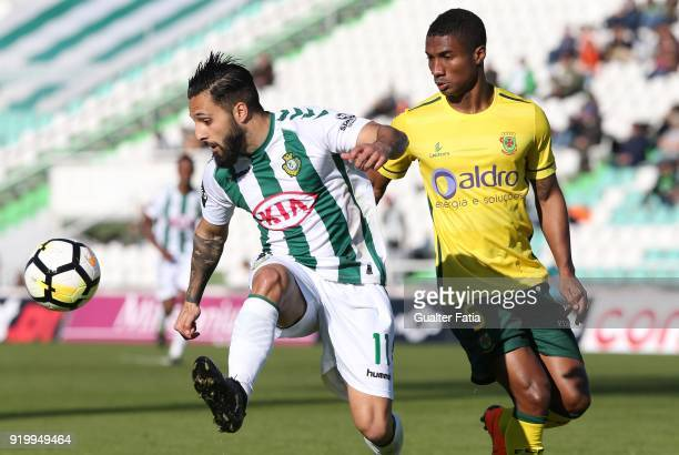 Vitoria Setubal midfielder Joao Costinha from Portugal with FC Pacos de Ferreira defender Paulo Henrique from Portugal in action during the Primeira...