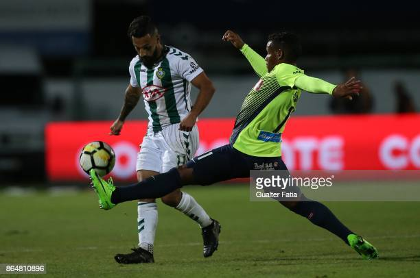 Vitoria Setubal midfielder Joao Costinha from Portugal with CS Maritimo midfielder Eber Bessa from Brazil in action during the Primeira Liga match...