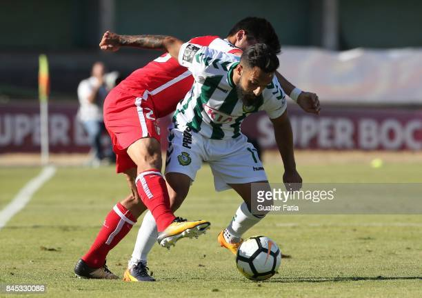 Vitoria Setubal midfielder Joao Costinha from Portugal with SC Braga forward Joao Carlos Teixeira from Portugal in action during the Primeira Liga...