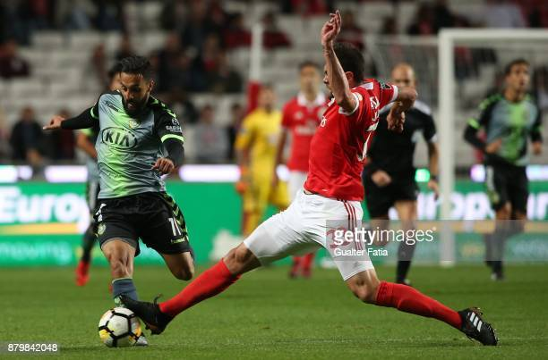 Vitoria Setubal midfielder Joao Costinha from Portugal with SL Benfica defender Jardel Vieira from Brazil in action during the Primeira Liga match...