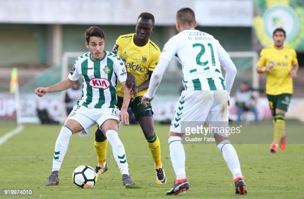 Vitoria Setubal midfielder Joao Teixeira from Portugal with FC Pacos de Ferreira forward Awer Mabil from Australia in action during the Primeira Liga...