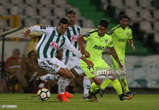 Vitoria Setubal midfielder Tomas Podstawski from Portugal with CD Aves forward Cristian Arango from Colombia in action during the Primeira Liga match...