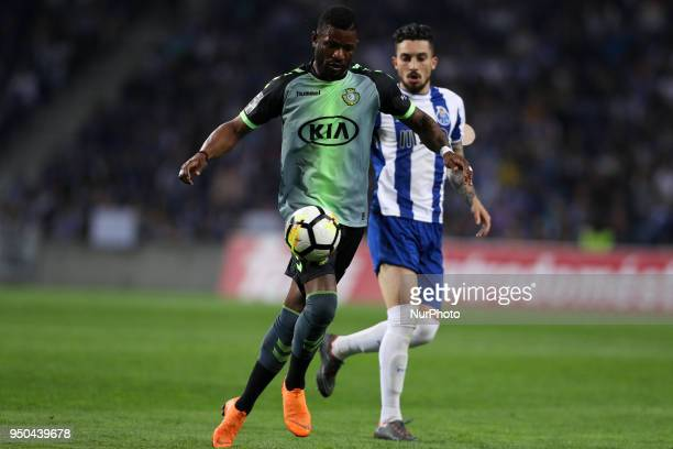 Vitoria Setubal's defender Arnold Issoko in action with Porto's Brazilian defender Alex Telles during the Premier League 2016/17 match between FC...