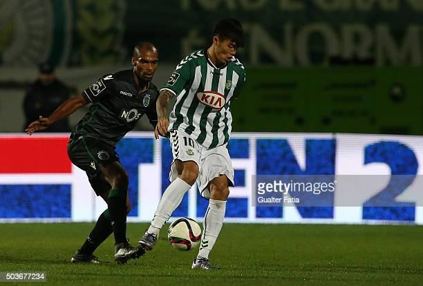 Vitoria SetubalÕs forward Suk HyunJun with Sporting CPÕs defender Naldo in action during the Primeira Liga match between Vitoria Setubal and Sporting...