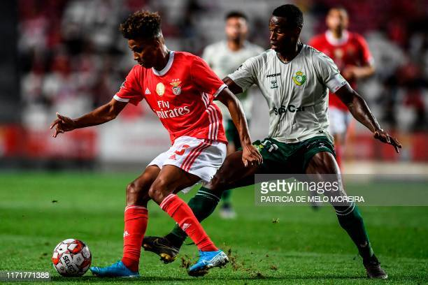 Vitoria Setubal's Portuguese defender Jose Semedo vies with Benfica's midfielder Gedson Fernandes during the Portuguese league football match between...