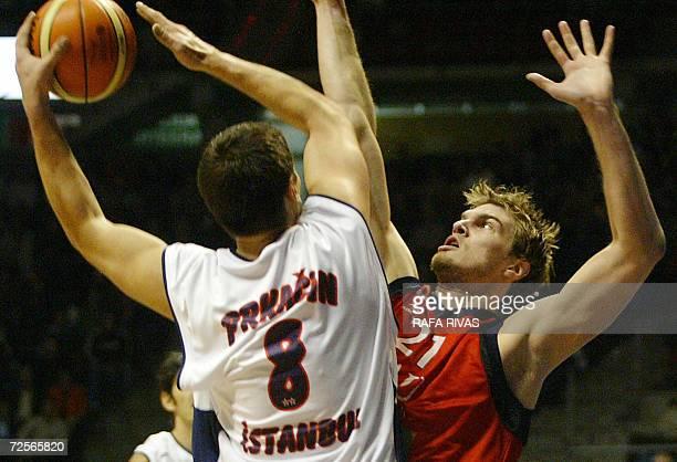 Tau Ceramica's Brazilian Tiago Splitter fights for the ball with Efes Pilsen's Nikola Prkacin during their Euroleague group A basketball match at the...