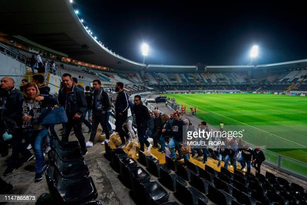 Vitoria supporters leave Afonso Henriques stadium after a football match in Guimaraes on May 5 2019 The small medieval city of Guimaraes will host...