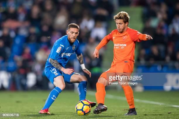 Vitorino Gabriel Pacheco Antunes of Getafe CF competes for the ball with Sergio Gontan Gallardo, Keko, of Malaga CF during the La Liga 2017-18 match...