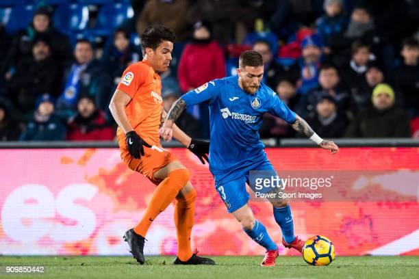 Vitorino Gabriel Pacheco Antunes of Getafe CF fights for the ball with Adalberto Penaranda of Malaga CF during the La Liga 201718 match between...