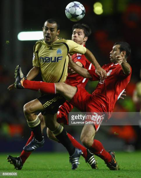 Vitorino Hilton of Marseille is challenged by Javier Mascherano and Xabi Alonso during the UEFA Champions League Group D match between Liverpool and...